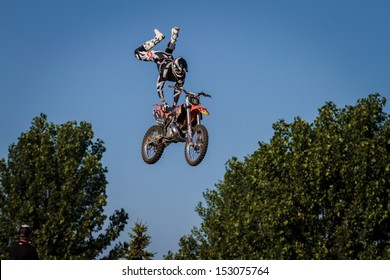 ESTAVAYER-LE-LAC, SWITZERLAND - JUL 06: Unidentified U.S. REDBULL FMX rider performs a trick during the 2013 Swatch Free4style Competition on July 06, 2013 in Estavayer, Switzerland.