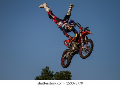 ESTAVAYER-LE-LAC, SWITZERLAND - JUL 06: Unidentified REDBULL FMX Team Member performs trick during the 2013 Swatch Free4style Competition on July 06, 2013 in Estavayer, Switzerland.