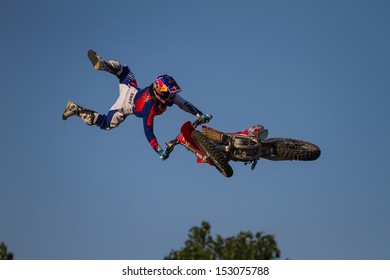 ESTAVAYER-LE-LAC, SWITZERLAND - JUL 06: Unidentified REDBULL FMX Rider Team Member performs trick during the 2013 Swatch Free4style Competition on July 06, 2013 in Estavayer, Switzerland.