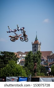 ESTAVAYER-LE-LAC, SWITZERLAND - JUL 07: FMX Riders Josh Sheehan (AUS) and Mat Rebeaud (SWI) perform dual trick during the 2013 Swatch Free4style Competition on July 07, 2013 in Estavayer, Switzerland.
