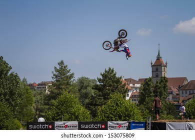 ESTAVAYER-LE-LAC, SWITZERLAND - JUL 07: Unidentified FMX REDBULL rider performs trick during the 2013 Swatch Free4style Competition on July 07, 2013 in Estavayer, Switzerland.
