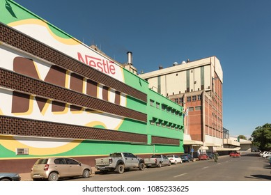 ESTCOURT, SOUTH AFRICA - MARCH 21, 2018: The Factory of the Nestle company in Estcourt in the Kwazulu-Natal Province. Vehicles and people are visible