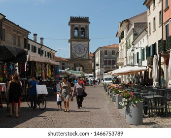 Este, Italy - July 17, 2019. Torre Civica di Porta Vecchia. Seventeenth-century tower located where one of the town gates stood centuries before. Square with weekly market.