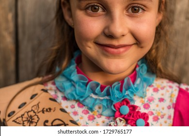 """Esteio, Rio Grande do Sul, Brazil - October 27, 2015: Cute little girl wearing traditional dress of Gaucho culture in a dance and music festival in a """"CTG""""  (Gaucho Traditional Center)"""