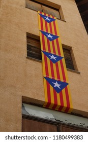 Estelada flags hang from building in town of Puigcerdà, Catalonia, Spain. This flag is typically flown by Catalan independence supporters to express their support for either an independent Catalonia
