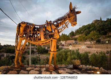 ESTELLENCS, SPAIN - OCT 5, 2018:  Scrap metal sculpture arts - a figure of a horse made out of trash in village Estellencs, Mallorca island, Spain