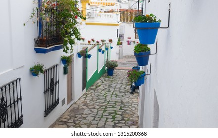 Estepona, Andalucia, Spain - December 25th 2017 : pretty blue plant pots along a typical spanish street