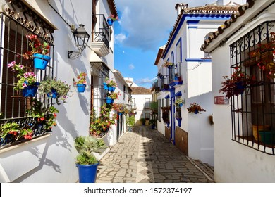 Estepona, Malaga / Spain - 11 26 2019: Beautiful colourful Estepona Old town small and narrow streets, traditional Mediterranean old Spanish houses with flowers, sunny historical center of Estepona