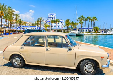 ESTEPONA PORT, SPAIN - MAY 9, 2018: Classic retro small car parking in Estepona port on Costa del Sol coast in southern Spain on sunny summer day.