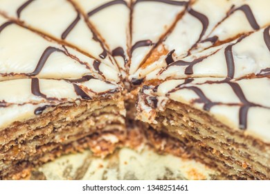 Esterhazy torte cake cut into pieces . Authentic recipe, hungarian and austrian dessert, view from above, close-up. Selective focus macro shot with shallow DOF