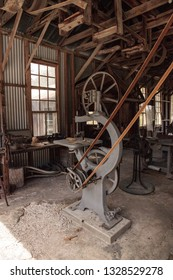 Estero, Florida, USA - February 23, 2019:  Norton Swing Saw inside the 1904 Large Machine Shop at historic Koreshan State Park.