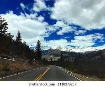 Estes Park, Colorado / United States - April 25, 2018:  Scenic snow-covered journey into the Rocky Mountains