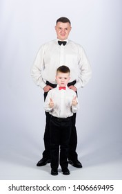esthete. male fashion. little boy with dad businessman. family day. father and son in formal suit. watchmaker concept. happy child with father. business meeting party. tuxedo style. watchmaker.