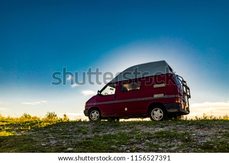 6ff2165720 ESTONIA - August 2018  VW Transporter T4 on baltic sea with sunset in  background and
