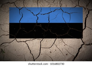 Estonia flag painted on cracked dry soil texture background