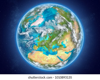 Estonia in red on model of planet Earth with clouds and atmosphere in space. 3D illustration. Elements of this image furnished by NASA.