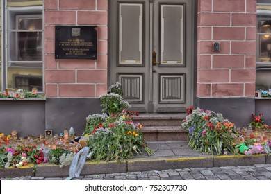 Estonia, Tallinn, 11/02/2015 Flowers, candles and toys - condolences over the terrorist act at the doors of the Russian embassy in Estonia.