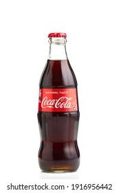 Estonia, Tallinn - 14.02.2021: Coca-Cola Classic in a glass bottle Isolated on white. single glass bottle of Coca-Cola