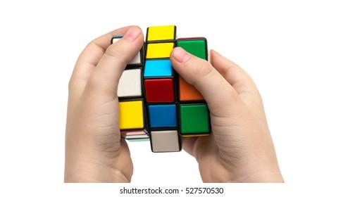 Estonia, Tallinn, November 30, 2016. Rubik's cube in hands on white background