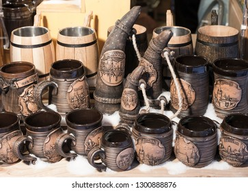 """Estonia, Tallinn - souvenir earthenware mugs with images of the city's attractions and the inscriptions """"Tallinn"""" and """"welcome"""" in Estonian"""