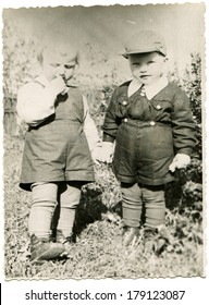 ESTONIA, VALGA - Sirca 1954: An antique photo of little boy and girl holding hands, standing in the garden, names unknown, about 2 years old