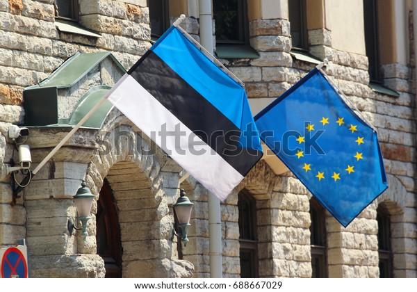 Estonian and European Union flags on facade of a building in Tallinn, Estonia