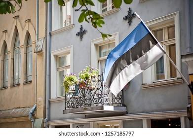 Estonian Flag Flying from a Balcony in Tallinn