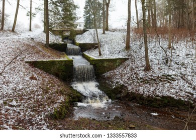 Estonian winter countryside. Cascase in the park of Palmse.