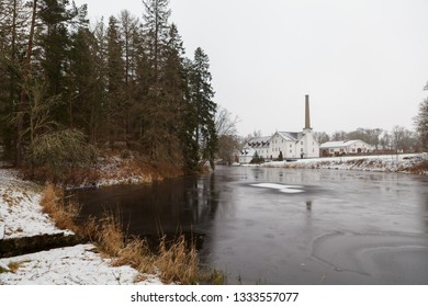 Estonian winter countryside. Lake and distillery of Palmse