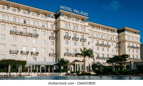 Estoril, Portugal - April 9th, 2019: Front facade of the famous Hotel Palacio which was frequented by both German and Allied spies during WWII, as well as Ian Fleming, creator of James Bond