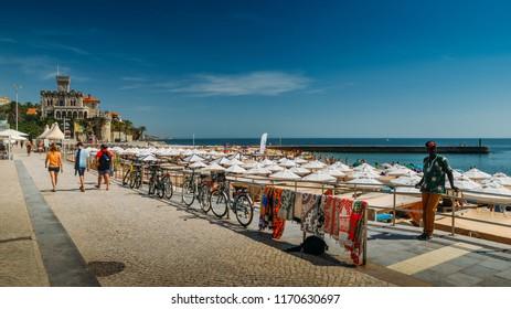Estoril, Portugal - August 30th, 2018: Boardwalk at Praia do Tamariz beach in Estoril, a popular beach with excellent infrastructure