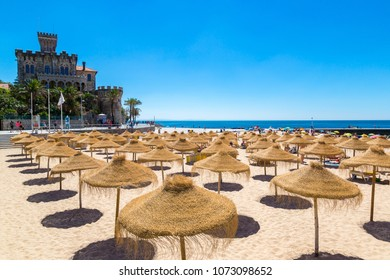 ESTORIL, PORTUGAL - JUNE 21, 2016: Umbrellas on public beach in Estoril in a beautiful summer day, Portugal on June 21, 2016