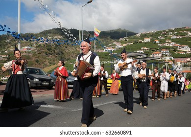 ESTREITO DE CAMARA DE LOBOS, PORTUGAL - SEPTEMBER 10, 2016: Folk music group in local costumes performs  a folk dance at Madeira Wine Festival in Esterito de Camara de Lobos on the Madeira, Portugal.