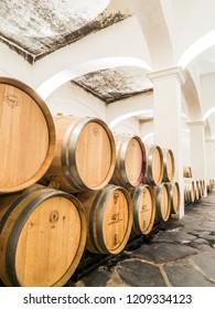 Estremoz, Portugal - August 21, 2018: Wine barrels in Herdade das Servas winery cellar in Alentejo region, Portugal.