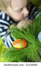 Estrer painted egg on grass