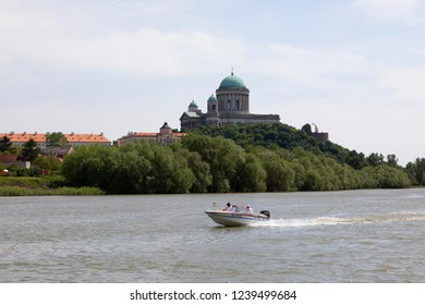 Esztergom Hungary 4 30 2018:  View of the Esztergom Basilica  with a speedboat with on the Castle Hill from the opposite bank of Danube, Hungary.  It's a World Herotage Site.