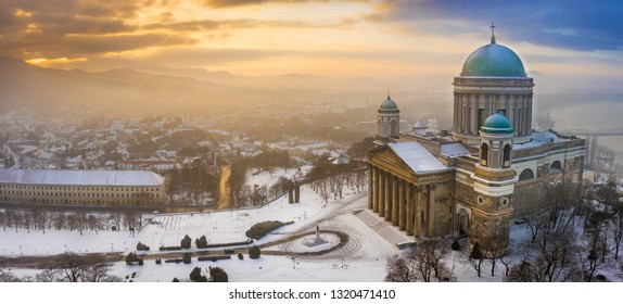Esztergom, Hungary - Aerial panoramic view of the snowy Esztergom Basilica on a foggy winter sunrise