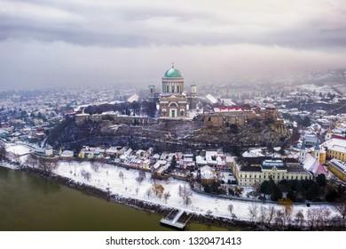 Esztergom, Hungary - Aerial skyline view of Esztergom with the beautiful snowy Basilica on a foggy winter morning