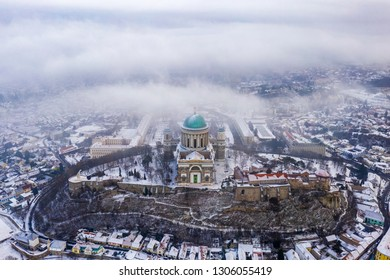 Esztergom, Hungary - Aerial view of the beautiful snowy Basilica of Esztergom on a foggy winter morning