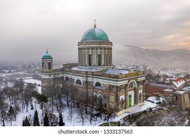 Esztergom, Hungary - Aerial view of the beautiful snowy Basilica of Esztergom on a foggy winter morning