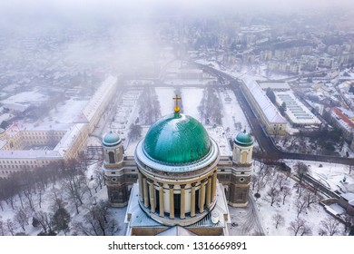 Esztergom, Hungary - Aerial view of the dome of the beautiful snowy Basilica of Esztergom on a foggy winter morning