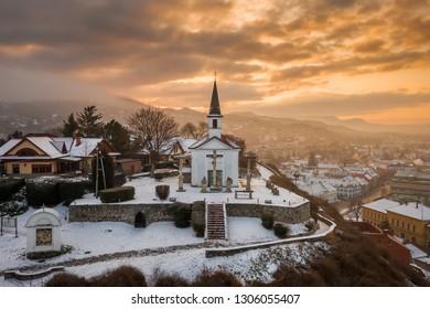 Esztergom, Hungary - Amazing golden sunrise at the Sorrowful Virgin Chapel on a misty winter morning