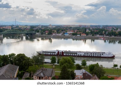 Esztergom, Hungary - May 25, 2018: A view over the Danube river from Esztergom in Hungary to Slovakia with a tourist boat on the river