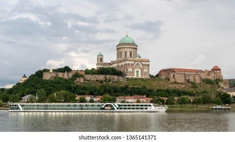 Esztergom, Hungary - May 25, 2018: Tourist boat on Danube river passing the famous Esztergom basilica in Hungary