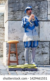 Esztergom, Hungary - May 26, 2019 : Pied piper performer in front of  Esztergom Basilica.