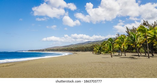 Etang-Sale, Reunion, October 2020 : Etang-Sale beach on Reunion Island with its characteristic black sand and the waves of the Indian Ocean