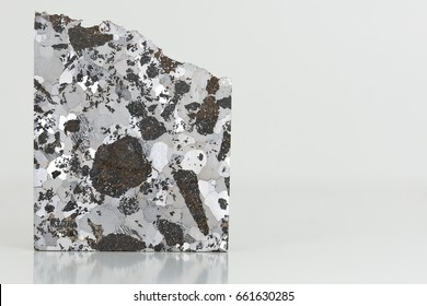 Etched face of a iron meteorite with silicate inclusions - NWA 5549