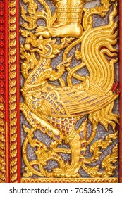 etching on Buddhist church door at Buddha Bucha Temple, Bangkok Thailand.