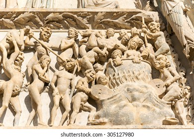 Eternal damnation in Bourges cathedral entrance, France
