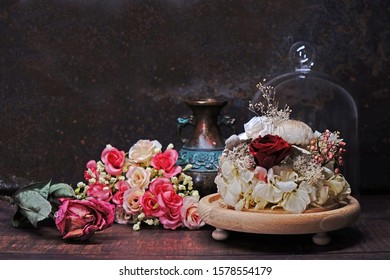 Eternal red rose and white Hydrangea flowers in crystal dome for room decoration during Valentine's day. DIY (Do It Yourself) of dried flowers, Idea for room interior. Selective focus with copy space